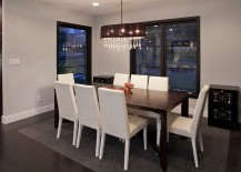 Gorgeous chandelier brings glamour to the cool dining space