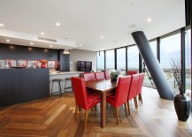 Gorgeous dining room with a lovely view and a splash of red