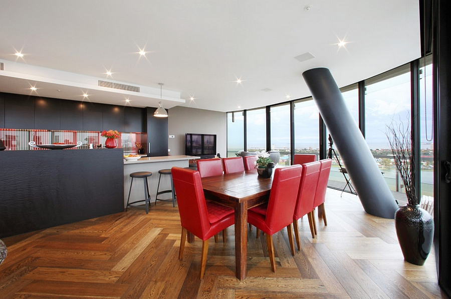 Gorgeous dining room with a lovely view and a splash of red [Design: Melbourne Contemporary Kitchens]