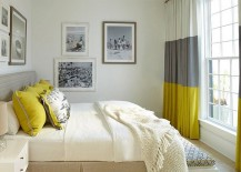 Gray and yellow bedroom with vintage black and white photograph on the walls