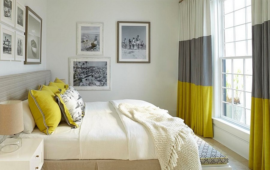 Gray and yellow bedroom with vintage black and white photograph on the walls [Design: Musso Design Group]