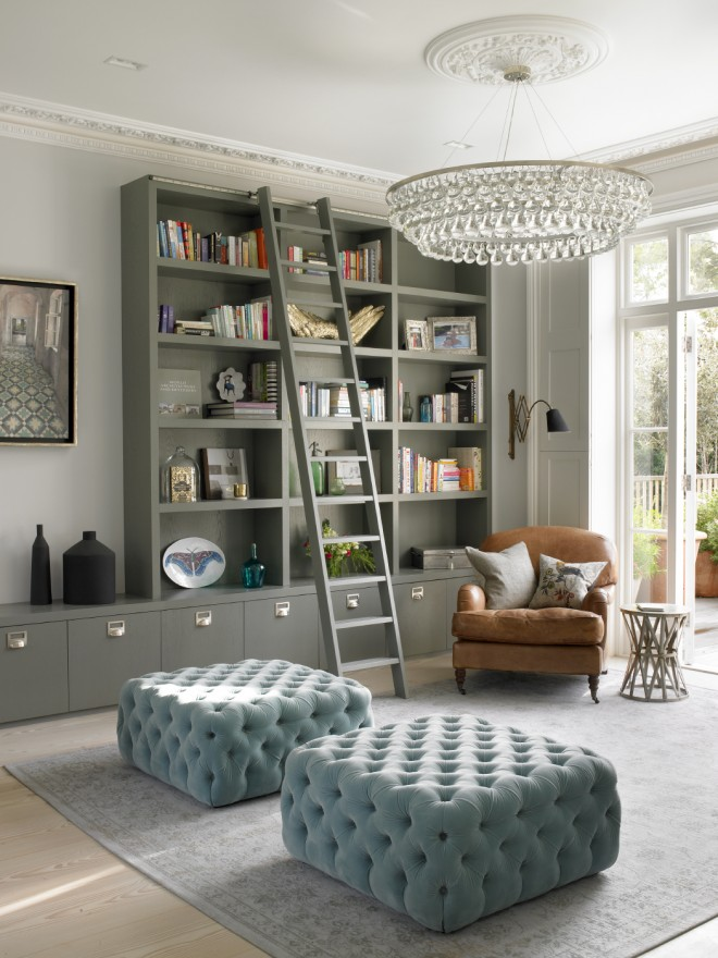 Grey Built-In Bookcase with Blue Tufted Ottomans