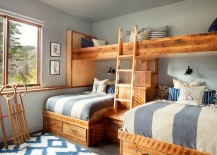Hint of blue and silvery gray enliven the rustic bedroom