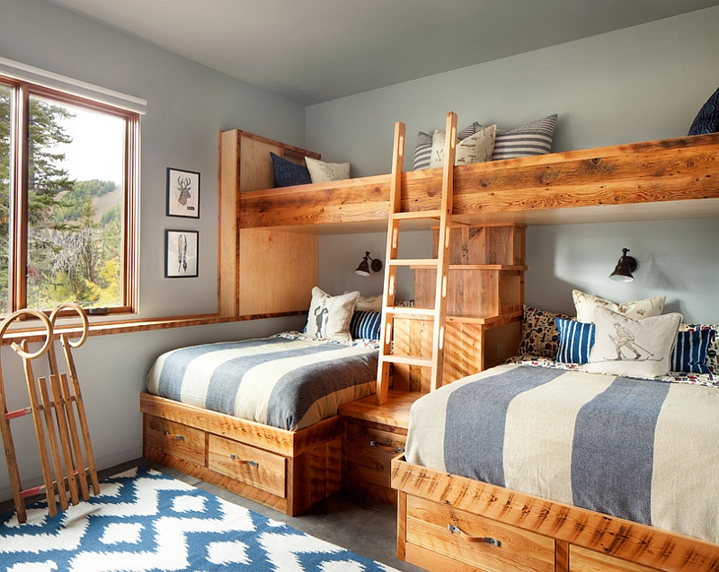 Hint of blue and silvery gray enliven the rustic bedroom [Design: Hunter and Company Interior Design]