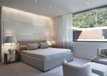 Illuminated accent wall in the bedroom brings texture to the space