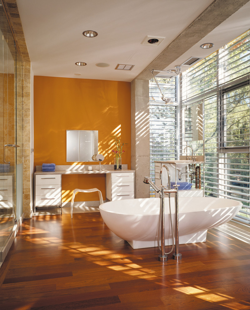 Industrial style bathroom with a dash of orange [Design: Thomas Roszak Architecture]