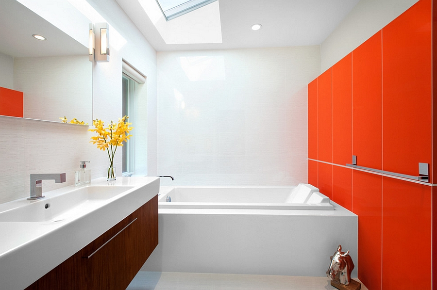 Intense orange in the contemporary bathroom steals the show [Design: CCI Renovations]