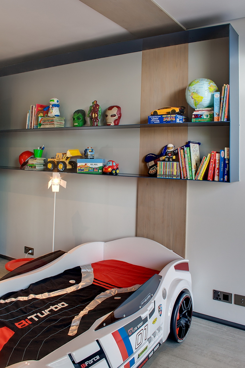 Kids' bedroom with a race car bed