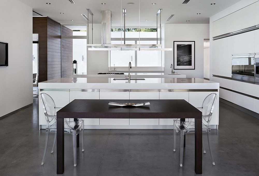 Kitchen and ining space in white with Ghost chairs