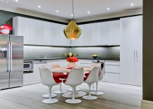 Large Beat Stout Pendant from Tom Dixon adds metallic glint to the kitchen and dining space
