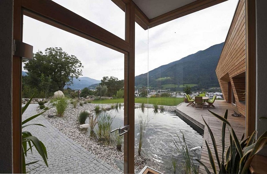 Large glass windows offer stunning view of the natural scenery outside