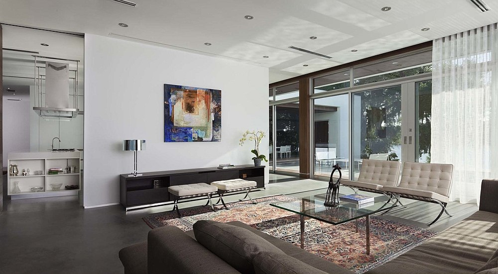 Large sliding glass doors and sheer curtains bring in plenty of natural light