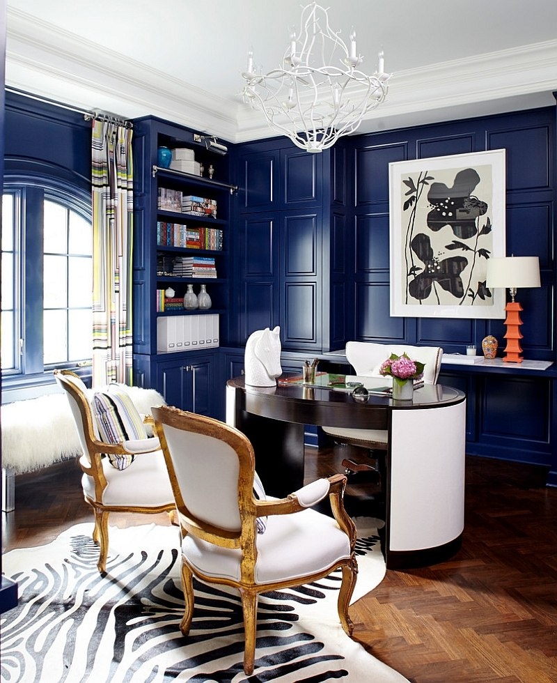 Leather desk and antique chairs add sophistication to the stylish home office [Design: Fun House Furnishings & Design]