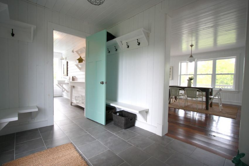 Light aqua door adds a subtle pop of color