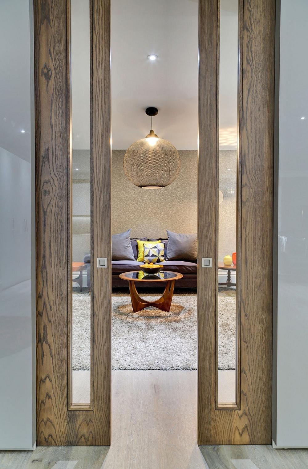 Living room with brilliant globe pendant and sliding wooden framed doors
