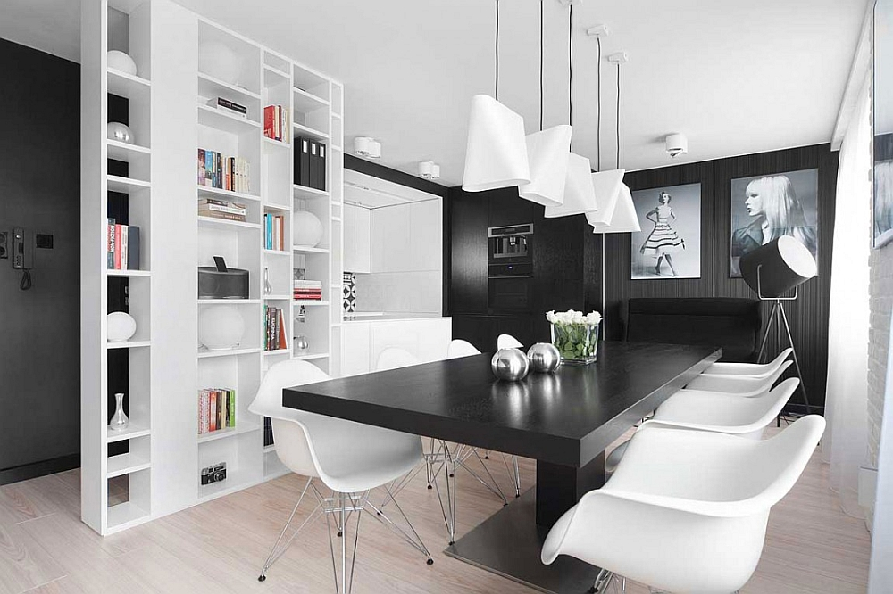 view in gallery lovely black and white photgraphs add to the monochromatic look of the apartment