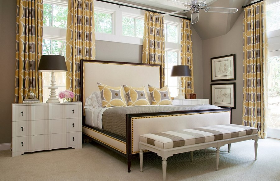 Lovely drapes accentuate the gray and yellow color palette in the room [Design: Tobi Fairley Interior Design]