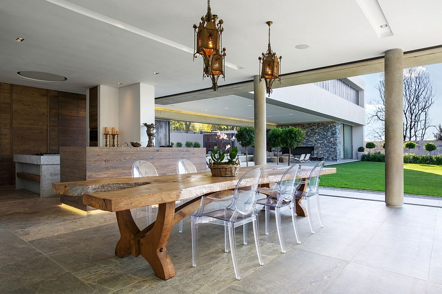 Lovely outdoor dining space and kitchen of the lavish Johannesburg house