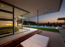 Master bedroom with glass walls overlooking the pool and the ocean