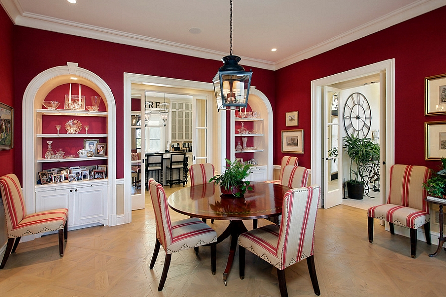 Mediterranean style dining room in ravishing red [Design: Cook Architectural Design Studio]