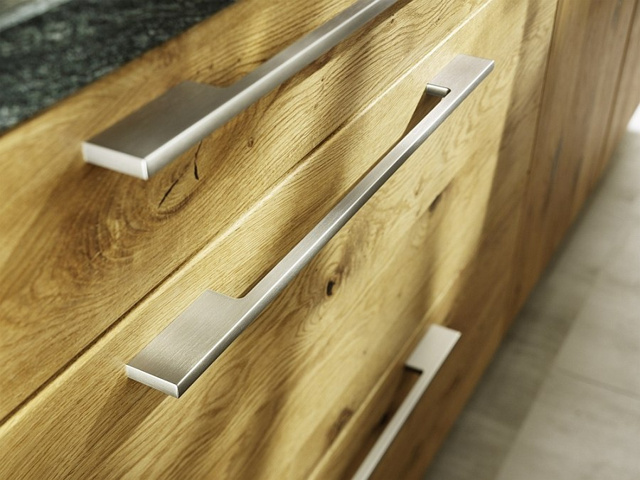 Metal handles complement the hand-sorted wooden surfaces  of the Loft kitchen