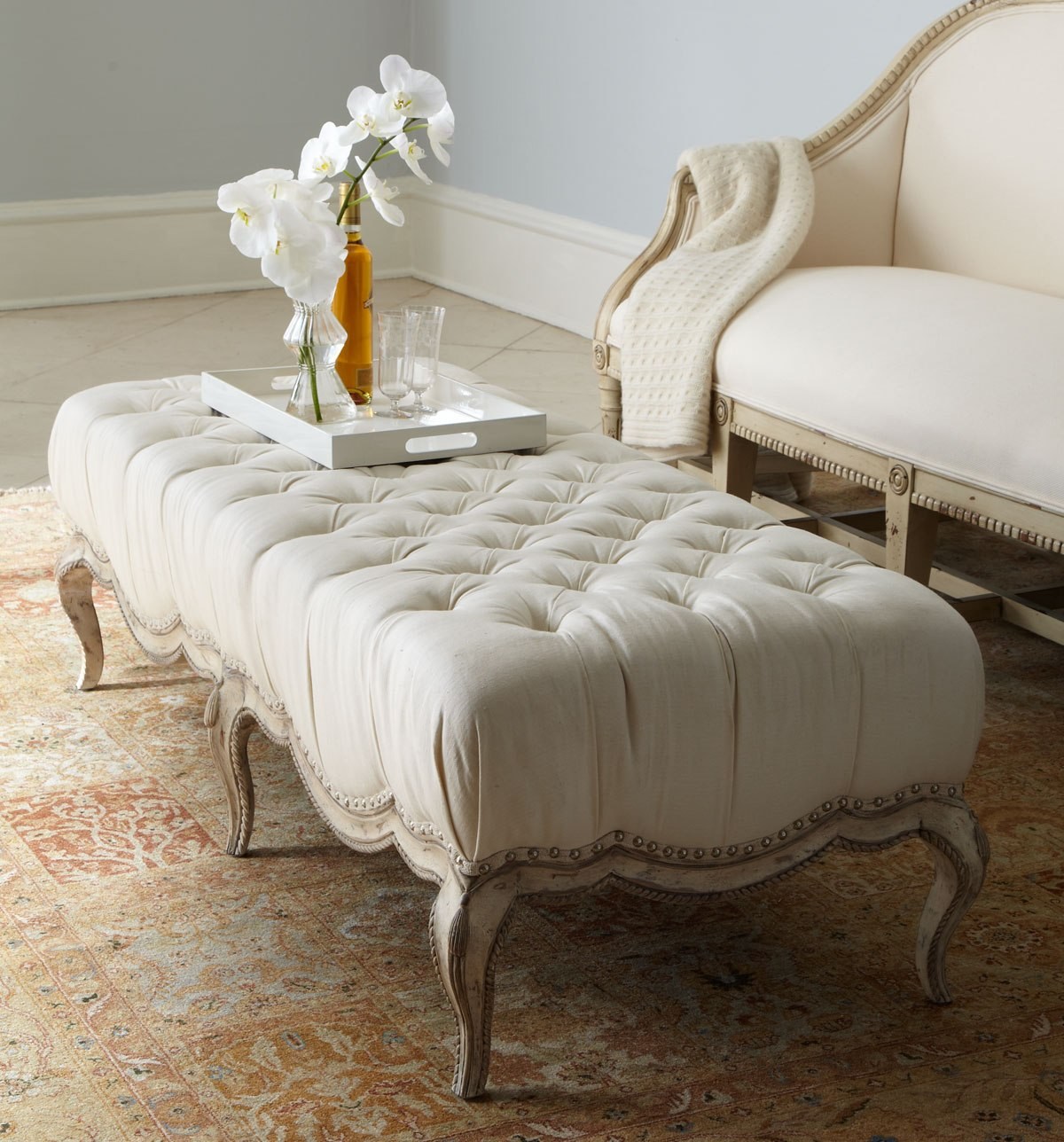 plush tufted ottomans to add comfort and functionality to your