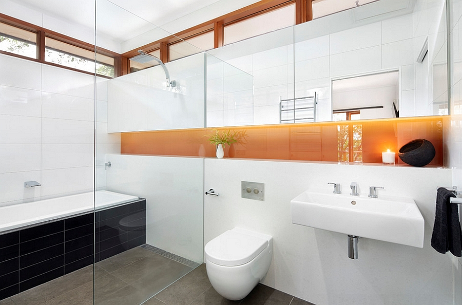 Modern Melbourne bathroom with an orange insert [Design: Eco Edge Architecture + Interior Design]