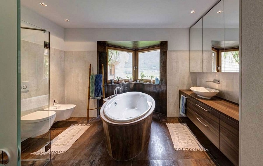 Modern bathroom with standalone bathtub and wooden vanity