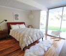 Modern bedroom with bamboo flooring by Teragren