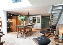 Modern kitchen with rough brick floor and natural finishes