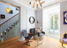 Modern lighting fixtures blend beautifully with the classical style of the London home