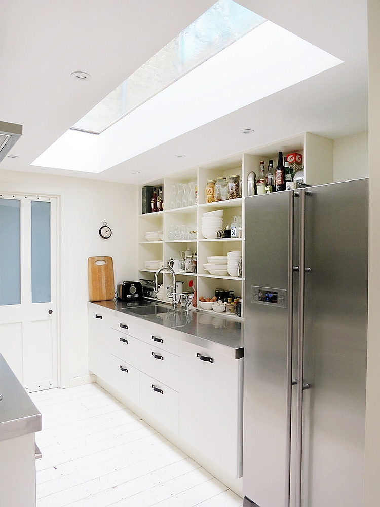 Narrow kitchen looks a lot more spacious thanks to the skylight