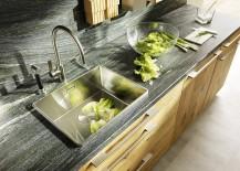 Natural-stone-countertop-and-backsplash-bring-visual-contrast-to-the-kitchen-217x155