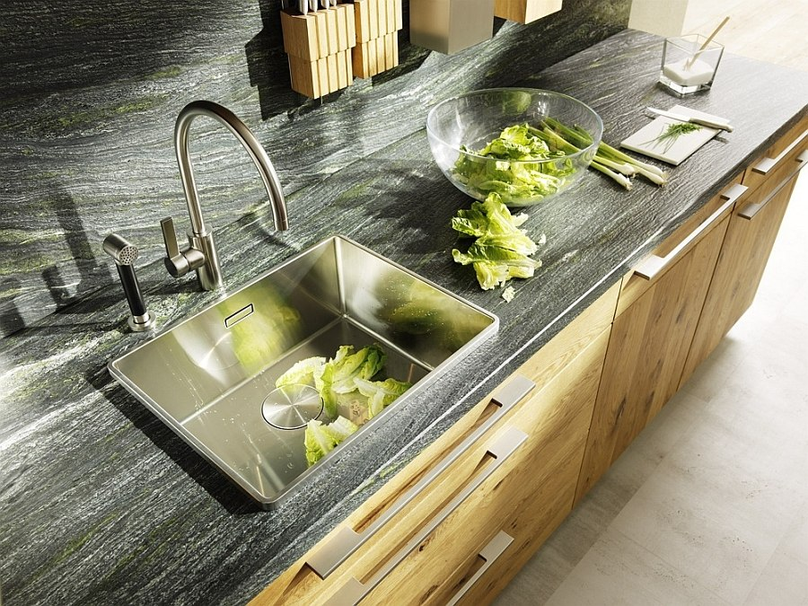 Natural stone countertop and backsplash bring visual contrast to the kitchen