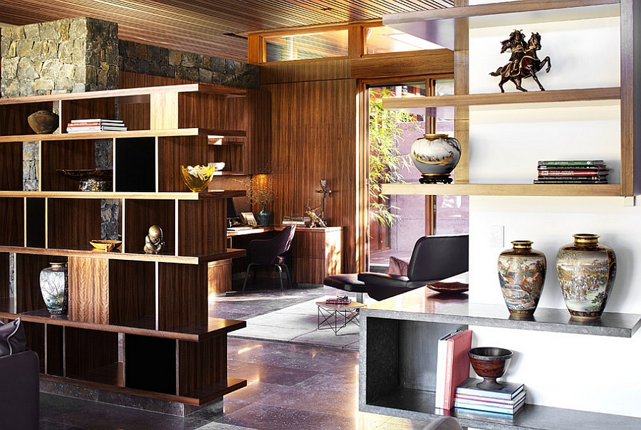 Open shelves separate the home office from the living area [Design: Suzanne Hunt Architect]