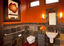 Orange brings dramatic charm to the cool bathroom