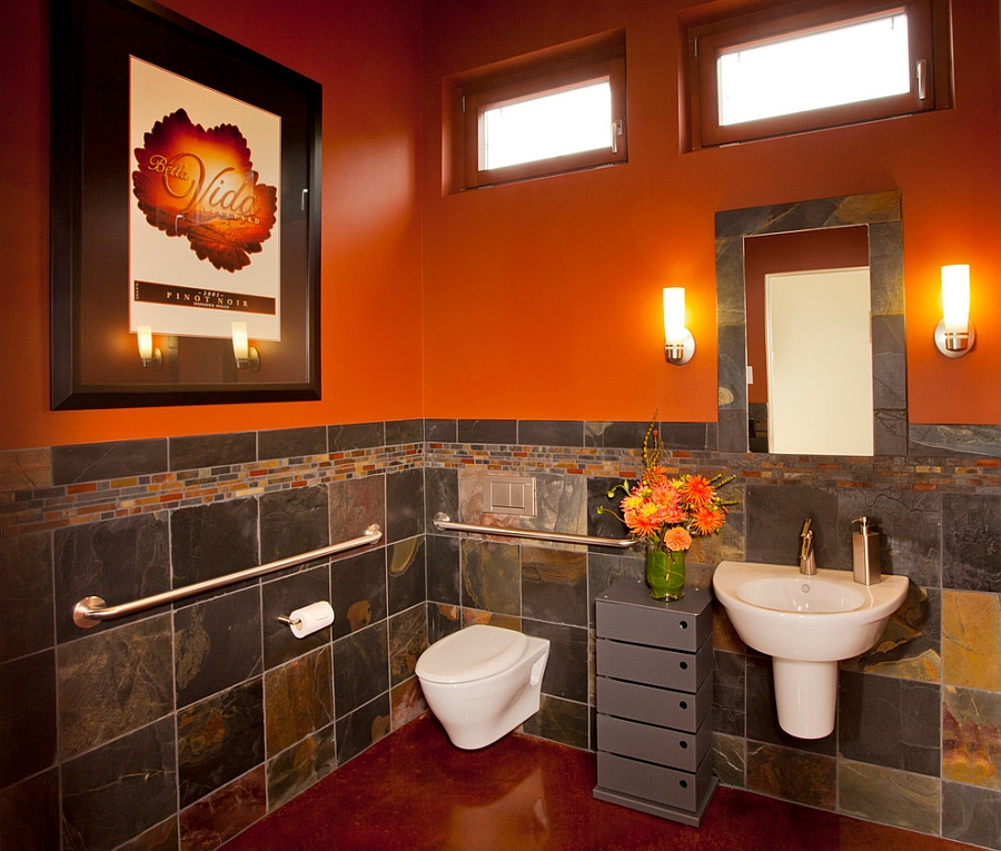 Orange brings dramatic charm to the cool bathroom [Design: L.Evans Design Group]