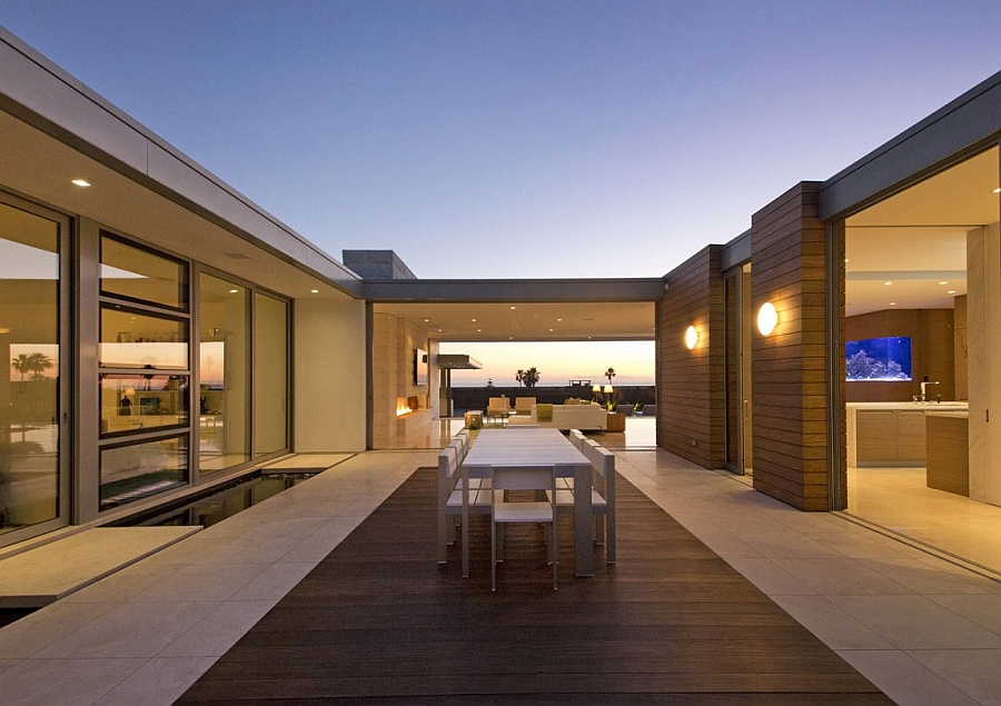 Outdoor dining space in the central courtyard of the luxurious residence