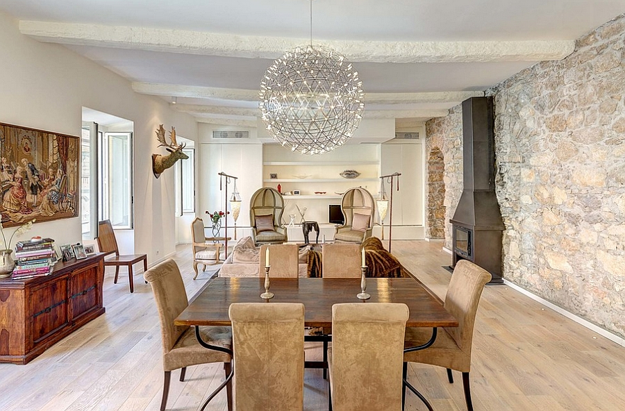 Pendant light becomes the focal point in the eclectic space [Design: Callender Howorth]