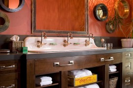 Pendant lights elevate the appeal of the rustic bathroom in orange