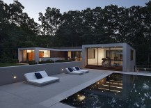 Pool area offers a relaxed spot surrounded by lush green vegetation