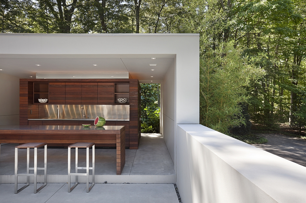 Pool house of the contemporary home with its own kitchen and barbecue area