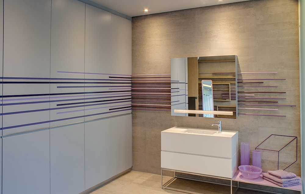 Pops of purple enliven the cool, contemporary bathroom