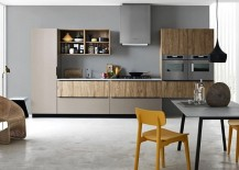Pops of yellow breathe life into the neutral kitchen space