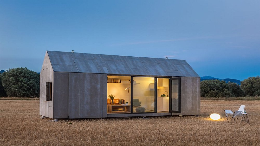 8 stunning modular homes that put the eco in interior decor for Prefab concrete house