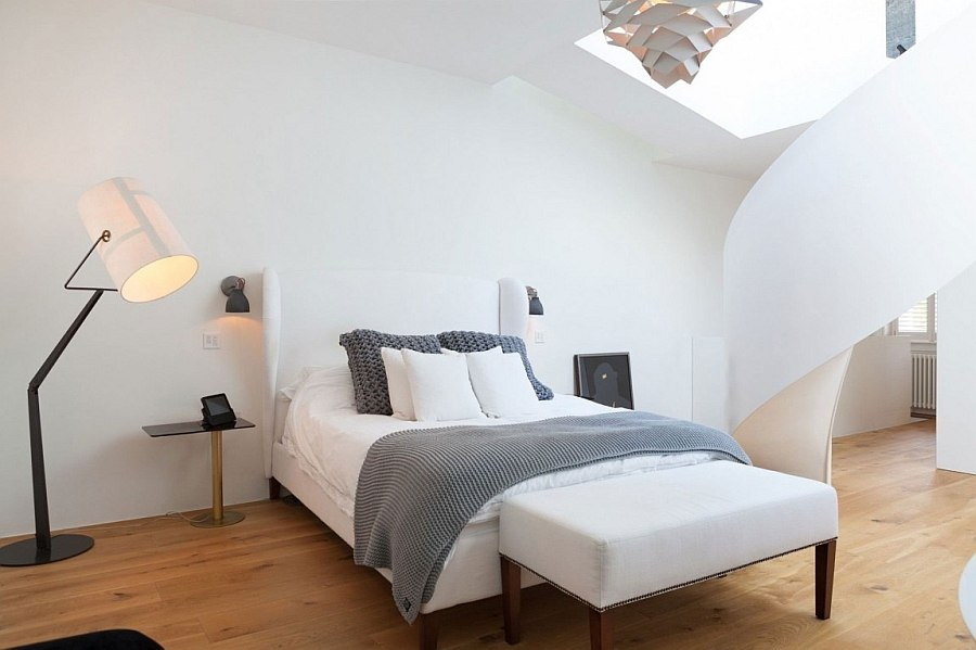 Relaxing master bedroom in white with a spiral staircase to the mezzanine level