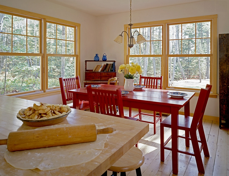 Rustic dining room with red table and chairs [Design: Whitten Architects]