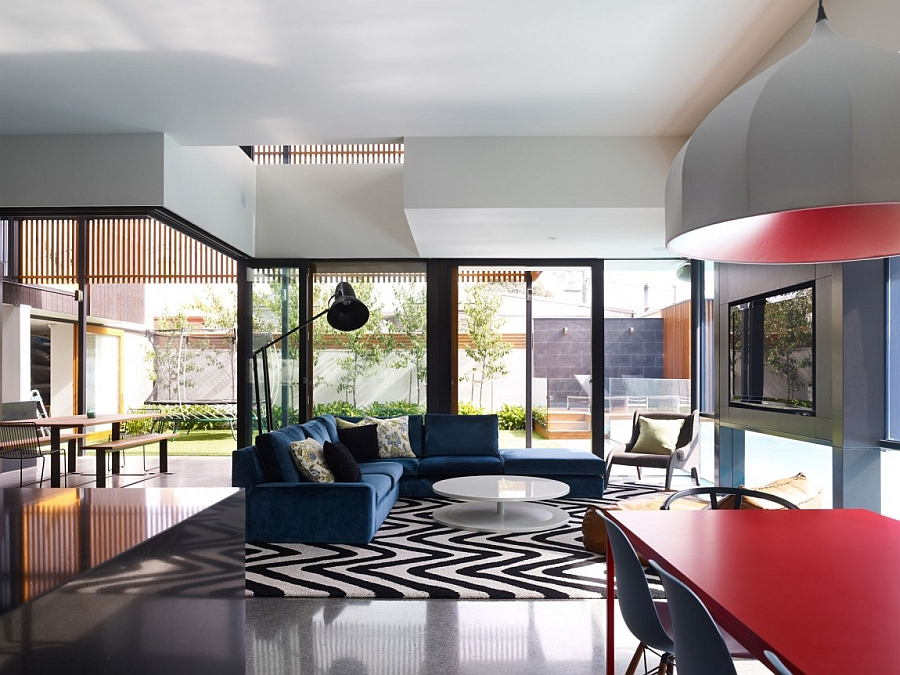 Sculptural lighting and a dash of red steal the show inside this Aussie home