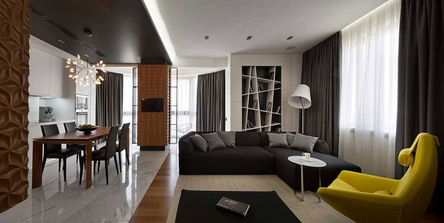 Scupltural wood panels on the wall add texture to the contemporary home