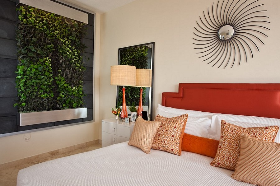 Serene contemporary master bedroom with a pop of orange [Design: NXG Studio]